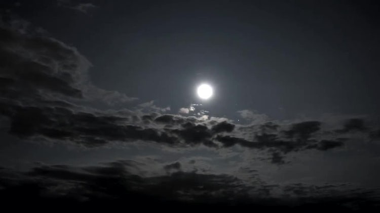 Rain Clouds Moving Under Moon: Stock Video
