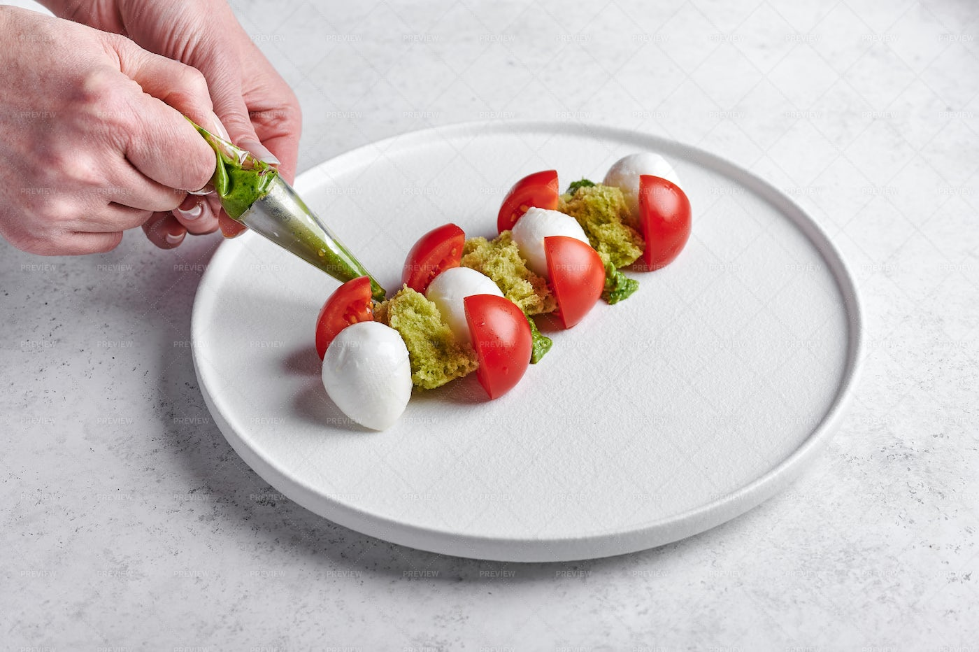 Woman's Hands Squeeze Out Pesto: Stock Photos