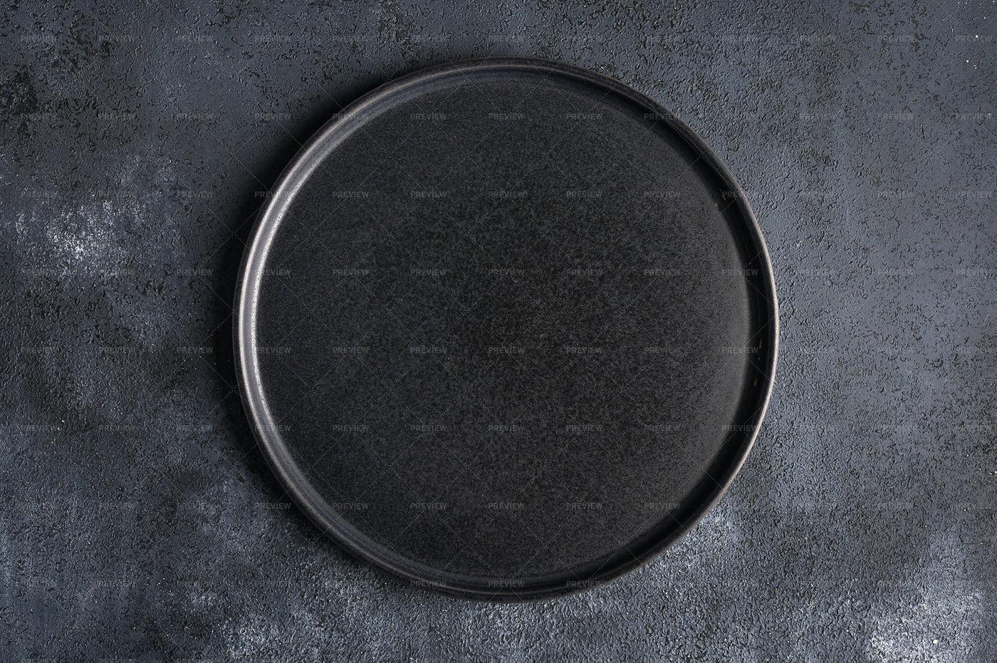 Empty Round Black Plate: Stock Photos