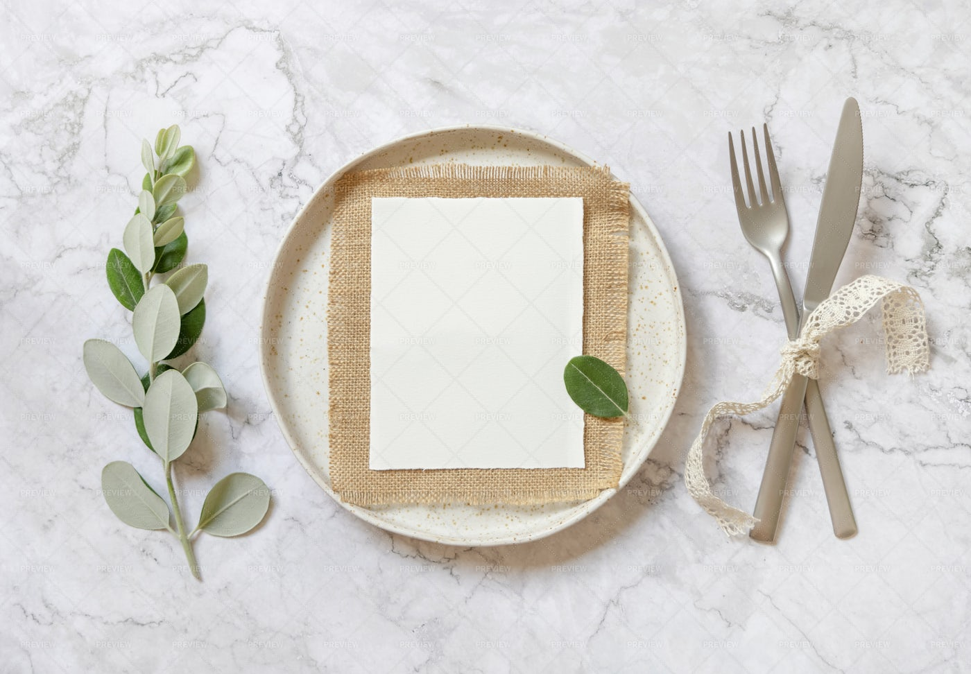 Paper Card On A White Plate: Stock Photos