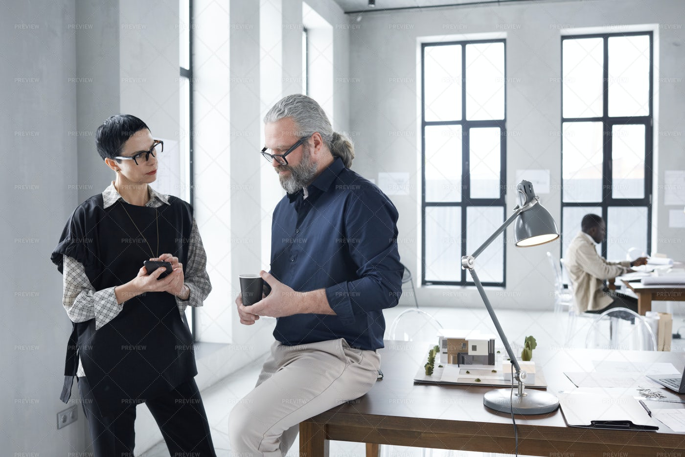 Architects Talking At An Office: Stock Photos