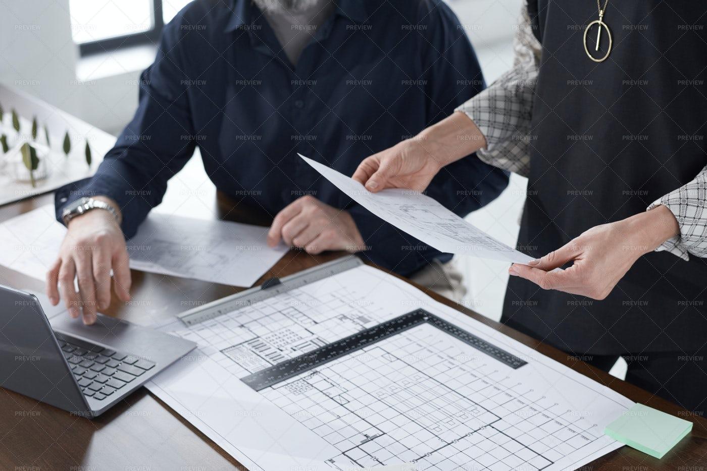 Architects Examining Blueprint: Stock Photos