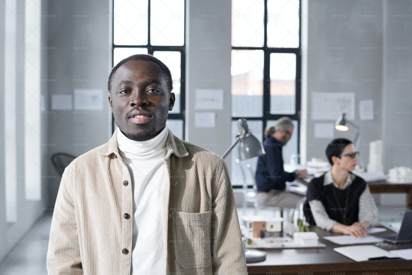 Worker Standing At Office: Stock Photos