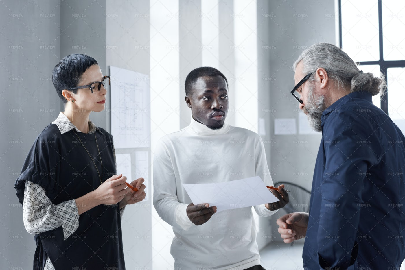 Business People Discussing Document: Stock Photos