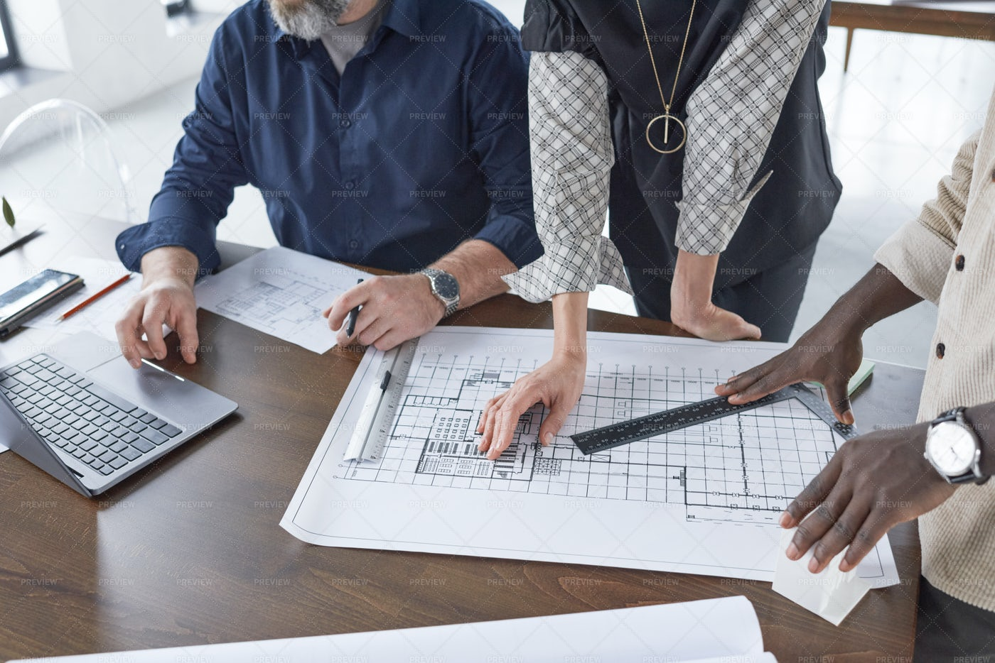 Drawing Blueprints In Team: Stock Photos