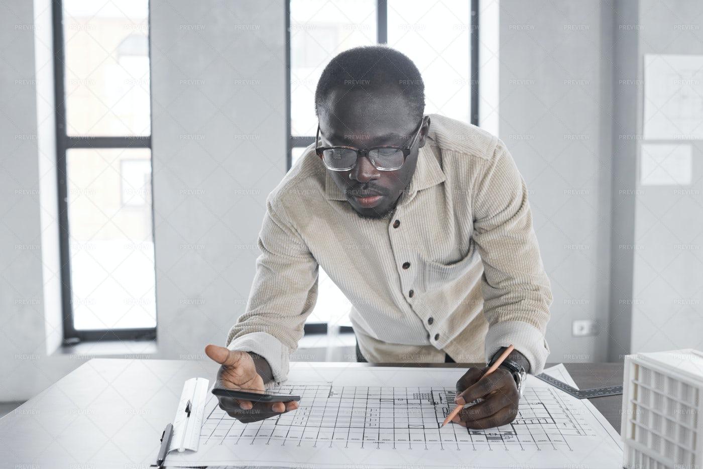 Architect Working Over Blueprint: Stock Photos