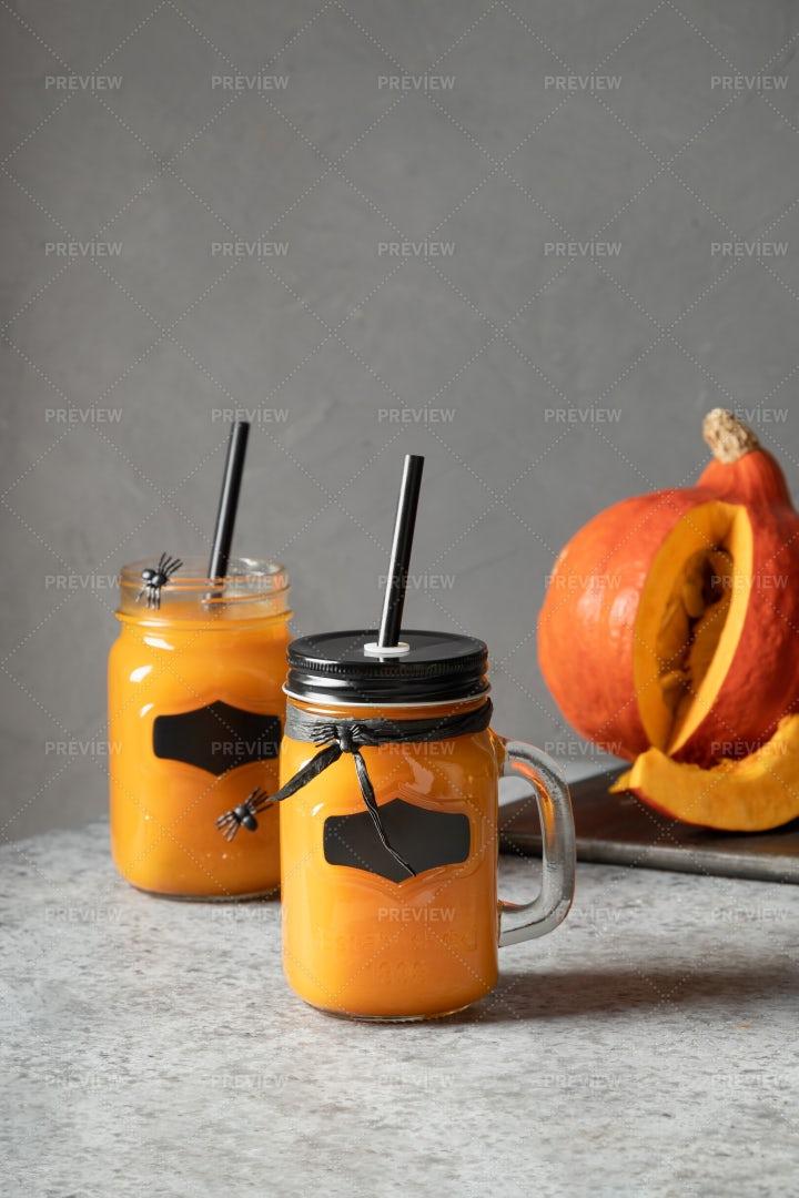 Halloween Cocktail With Pumpkin Juice: Stock Photos