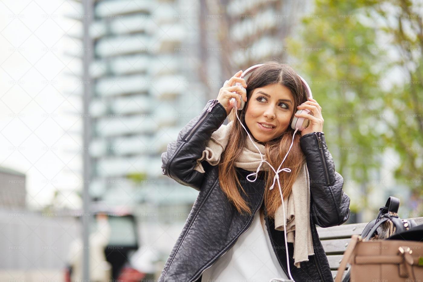 Woman Putting Her Headphones: Stock Photos