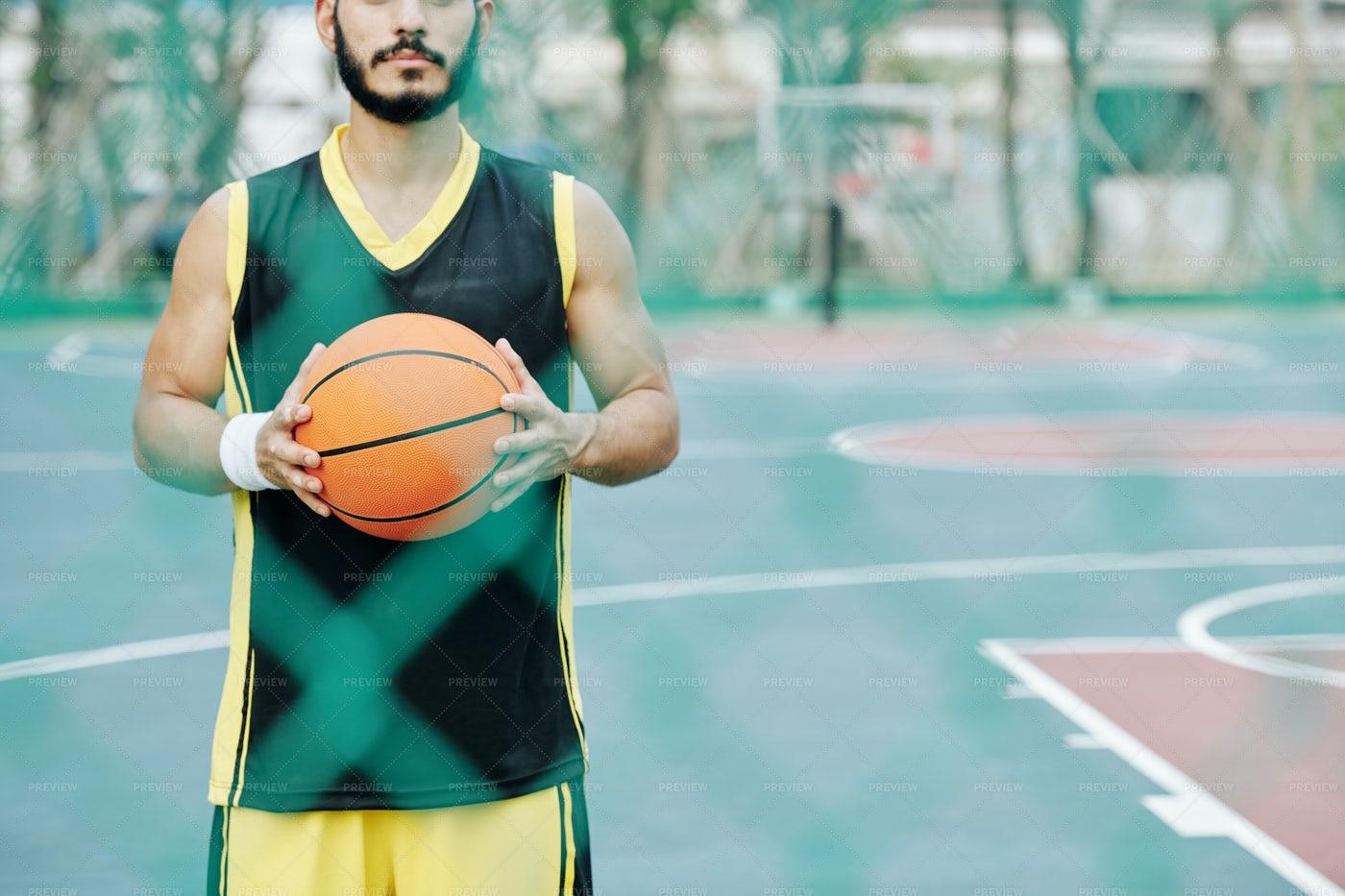 Basketball Player Holding Ball: Stock Photos