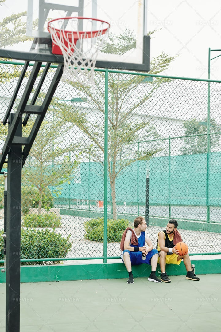 Friends Resting After Game Of Basketball: Stock Photos