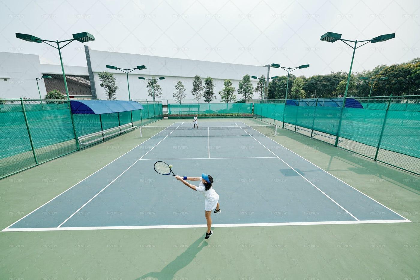 Tennis Player Jumping And Hitting Ball: Stock Photos
