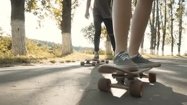 Young People Riding Skateboards: Stock Video