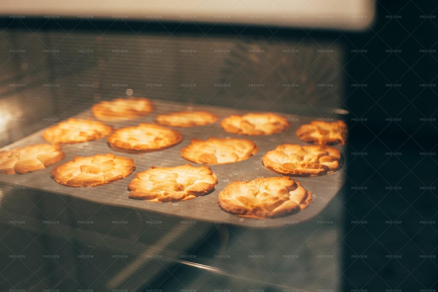 Pumpkin Pies In Oven: Stock Photos