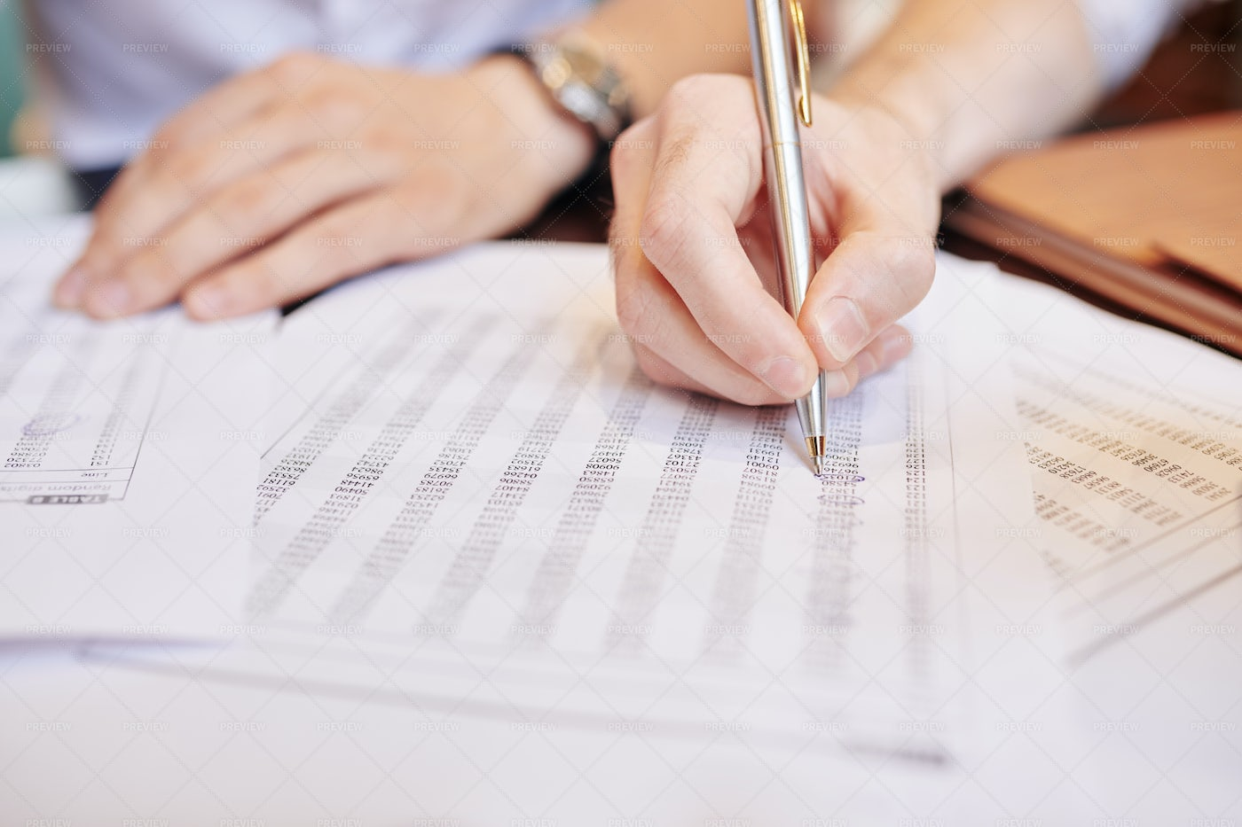 Business People Analyzing Document With: Stock Photos