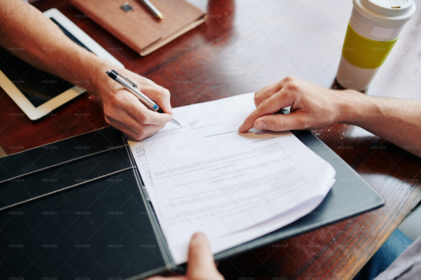 Business People Signing Agreement: Stock Photos