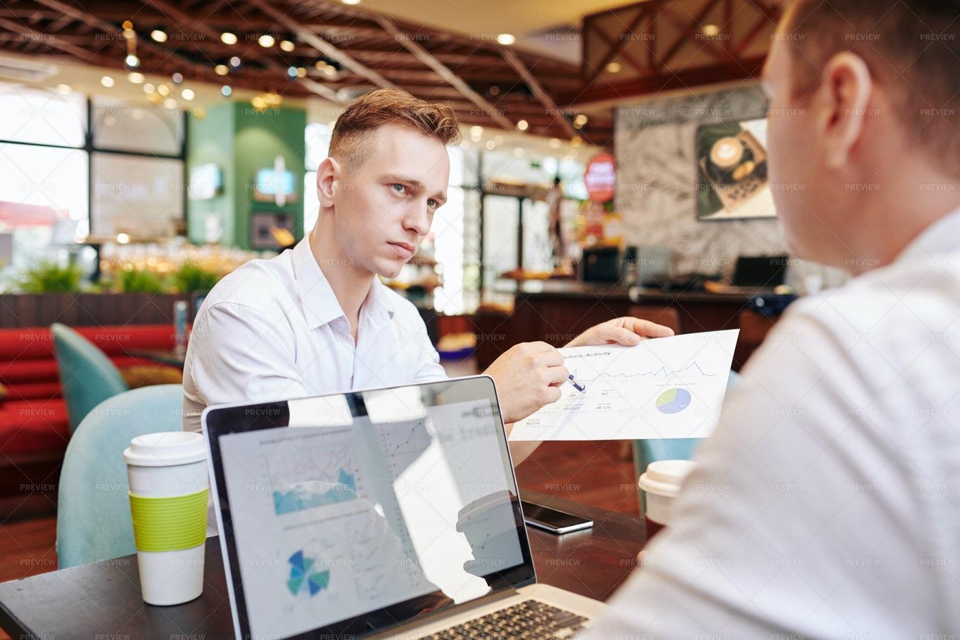 Financial Meeting In A Café: Stock Photos