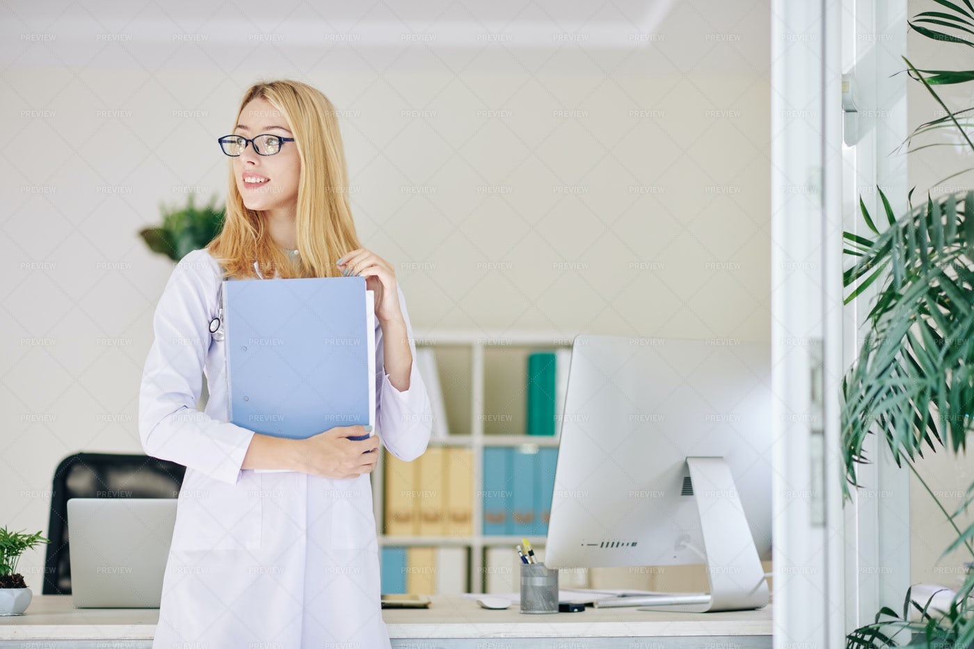 Doctor Holding Medical History: Stock Photos