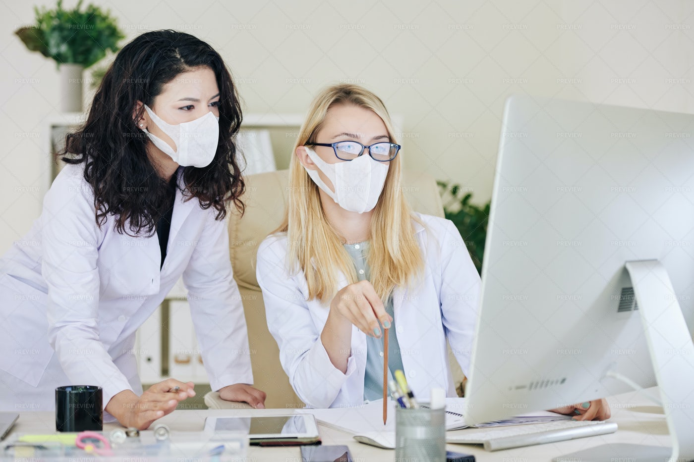 Laboratory Researchers Discussing Tests: Stock Photos