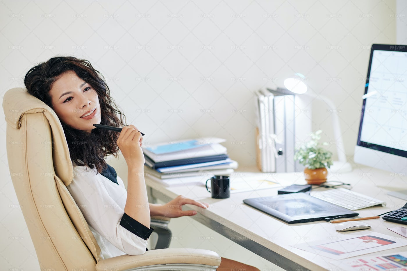 Woman Dreaming In Office: Stock Photos
