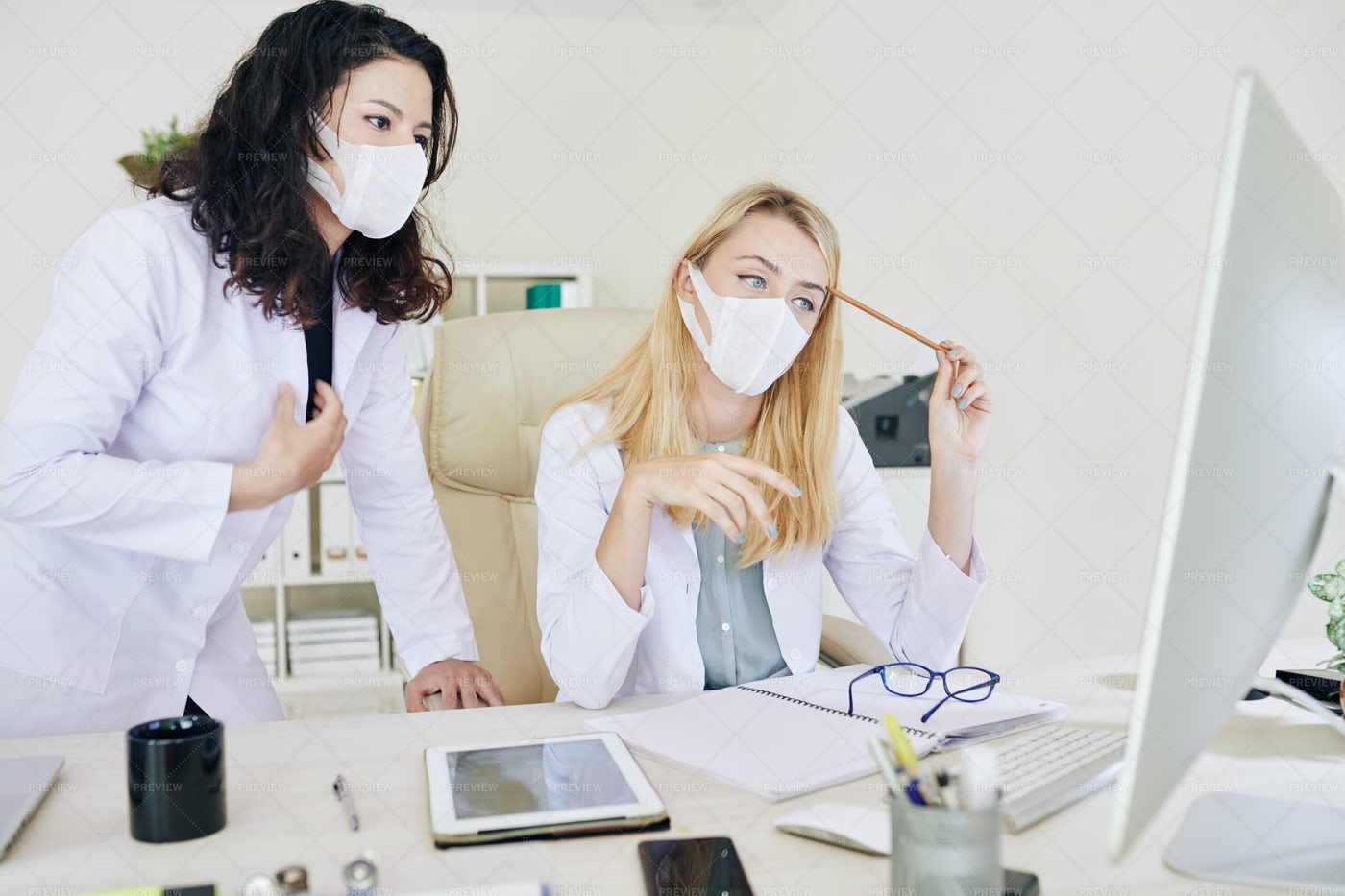 Doctors Researching Together: Stock Photos