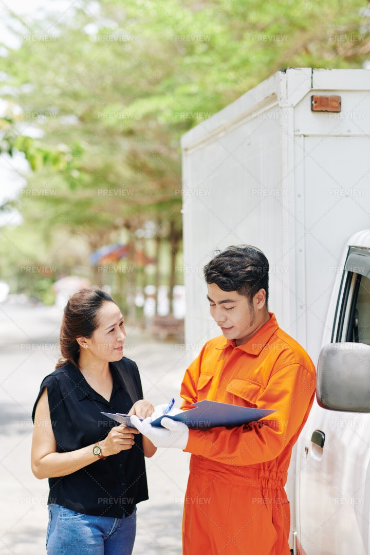 Delivery Driver Signing A Client: Stock Photos