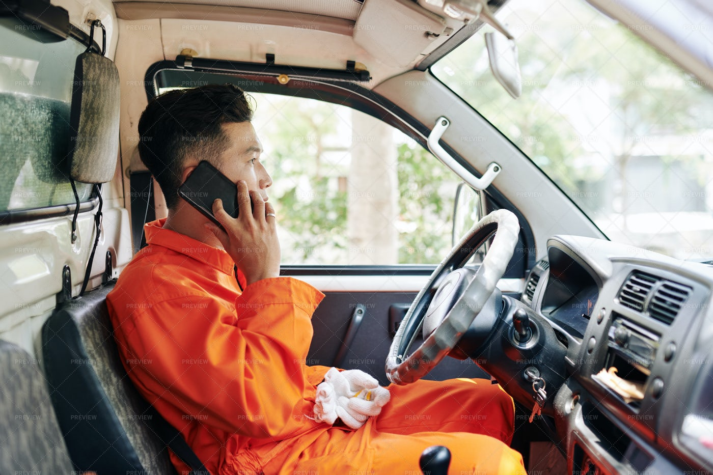 Delivery Driver Talking On Phone: Stock Photos