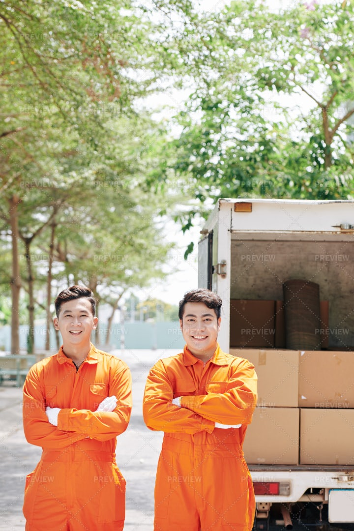 Two Loaders Stand In Front Of A Truck: Stock Photos