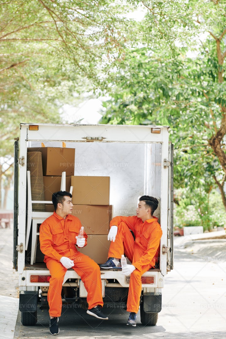 Movers Having Some Rest: Stock Photos