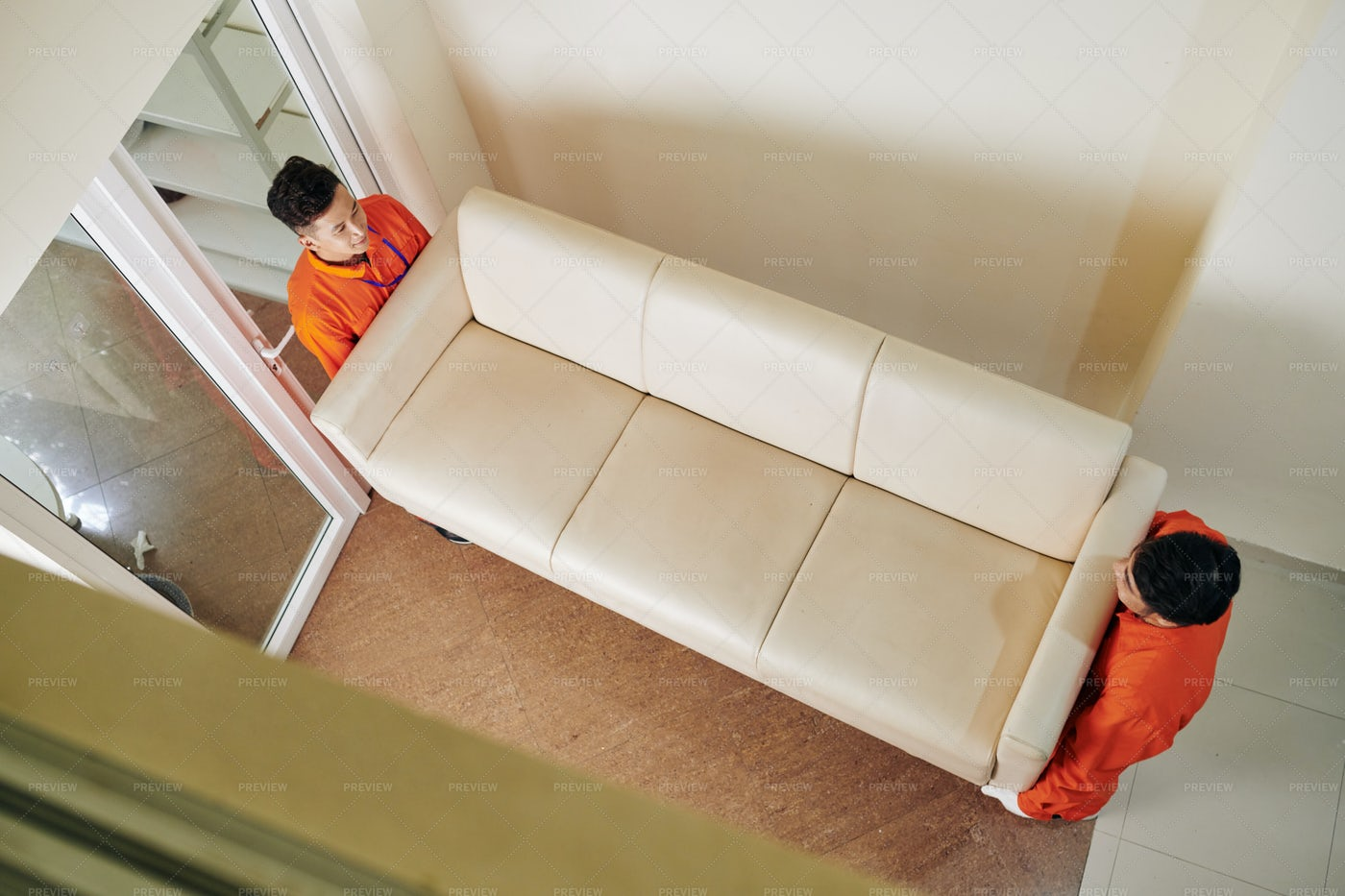 Movers Carrying Leather Sofa: Stock Photos
