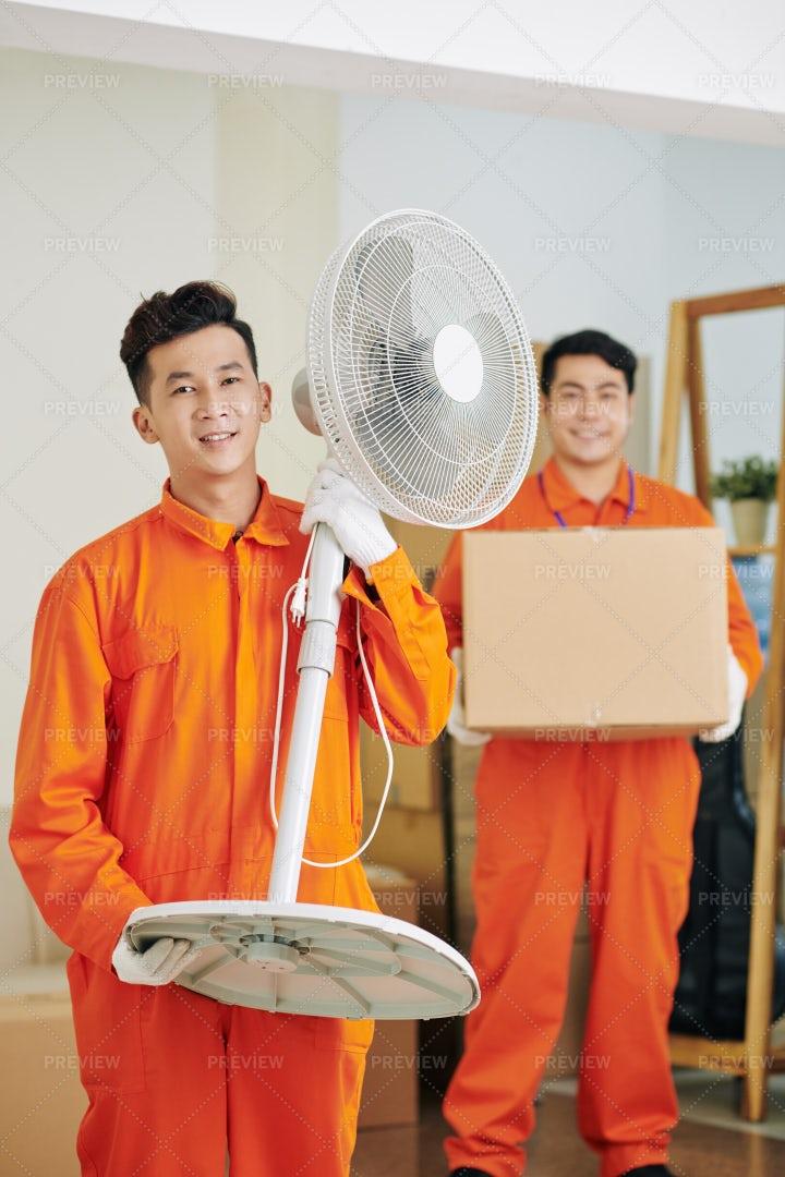Mover Holding Fan: Stock Photos