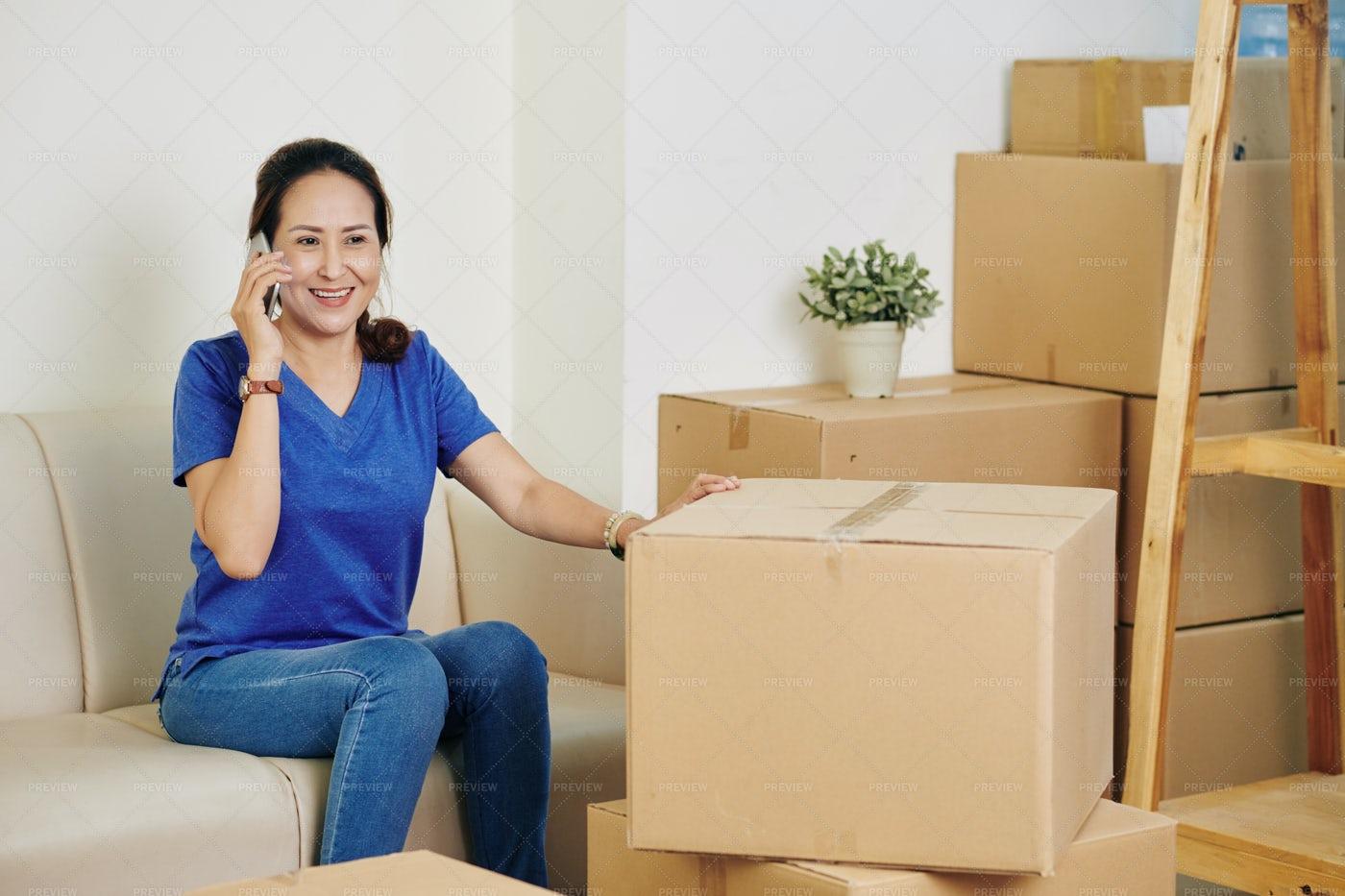 Talking To Moving Service Company: Stock Photos