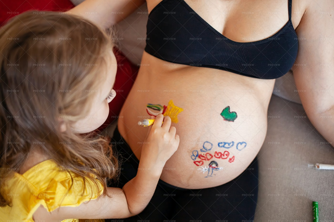 Painting On Pregnant Mother Belly: Stock Photos