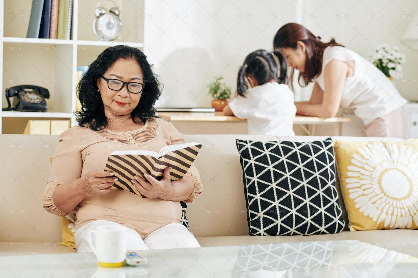 Senior Woman Reading Book: Stock Photos