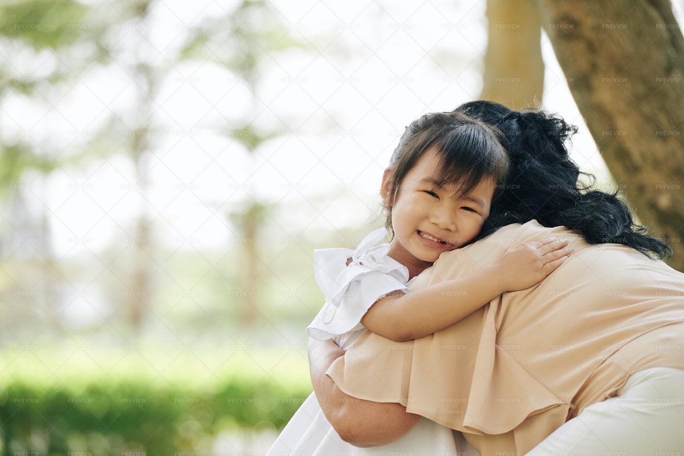 Girl Hugging Her Grandmother: Stock Photos