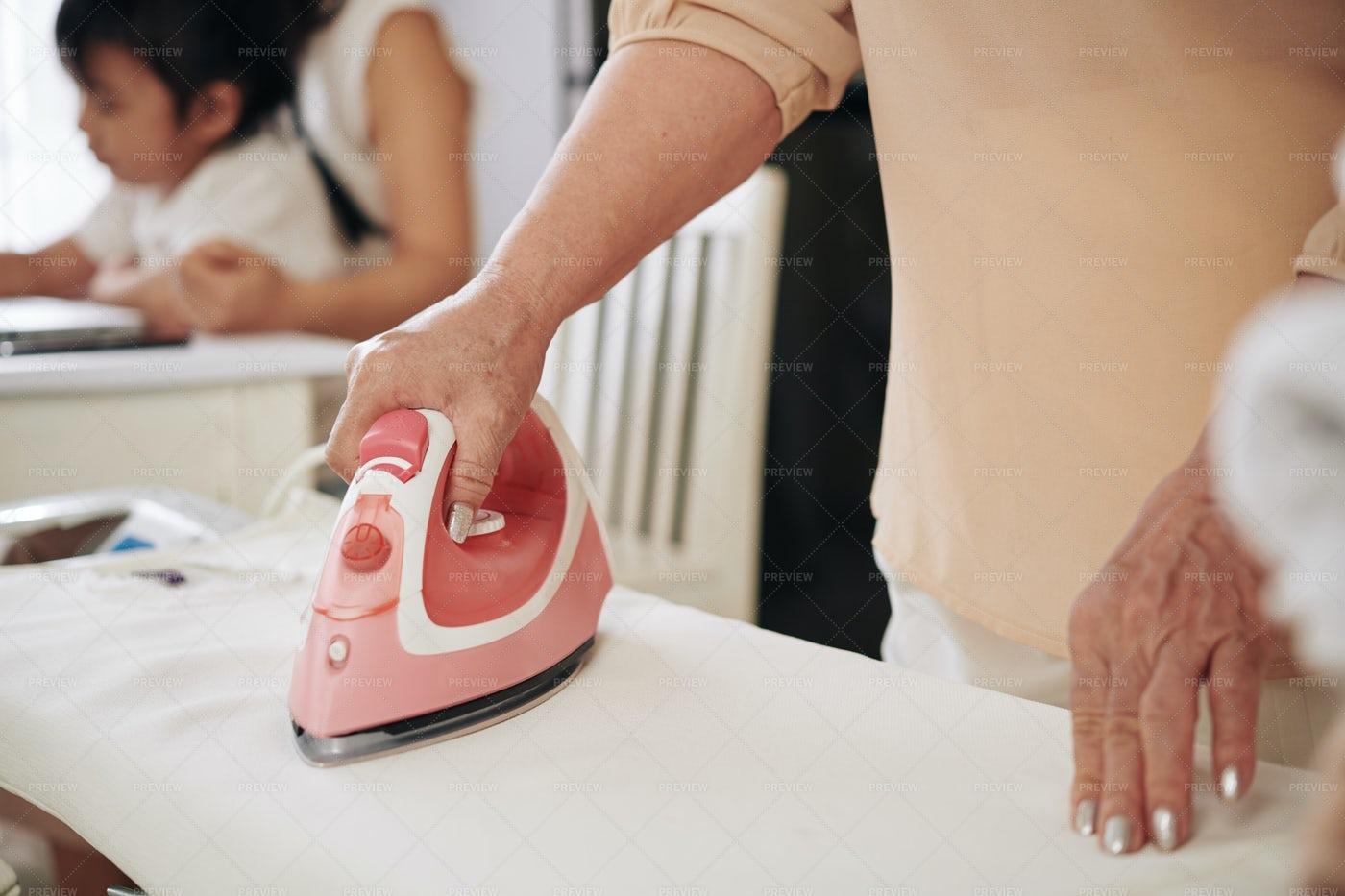 Woman Ironing Clothes: Stock Photos