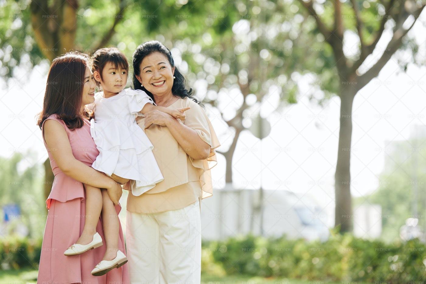 Family Enjoying Walk In The Park: Stock Photos