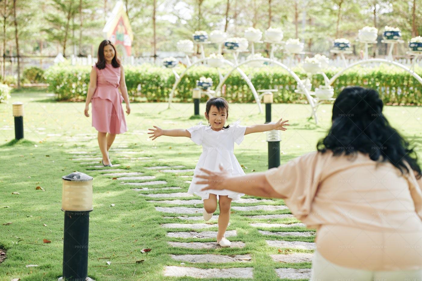 Girl Running To Her Grandmother: Stock Photos