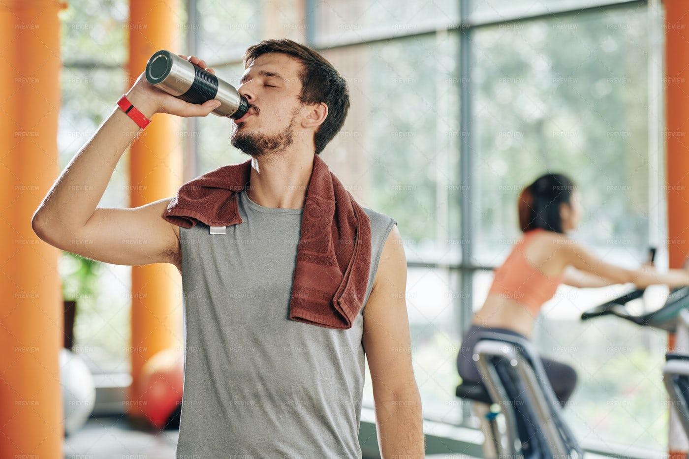 Thirsty Sportsman Drinking: Stock Photos