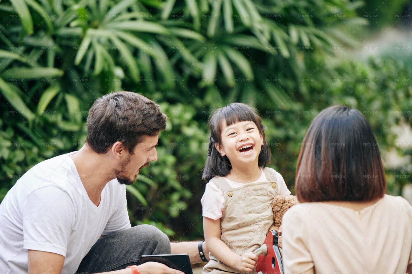 Happy Girl With Parents: Stock Photos