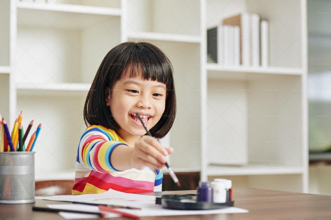 Happy Girl Painting: Stock Photos