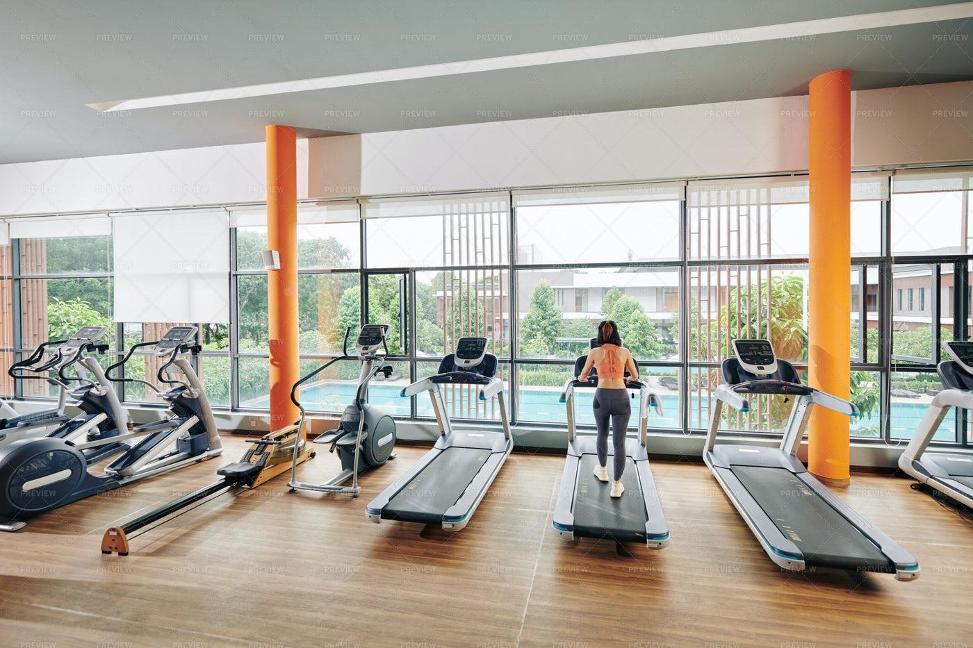 Woman Running On Treadmill: Stock Photos