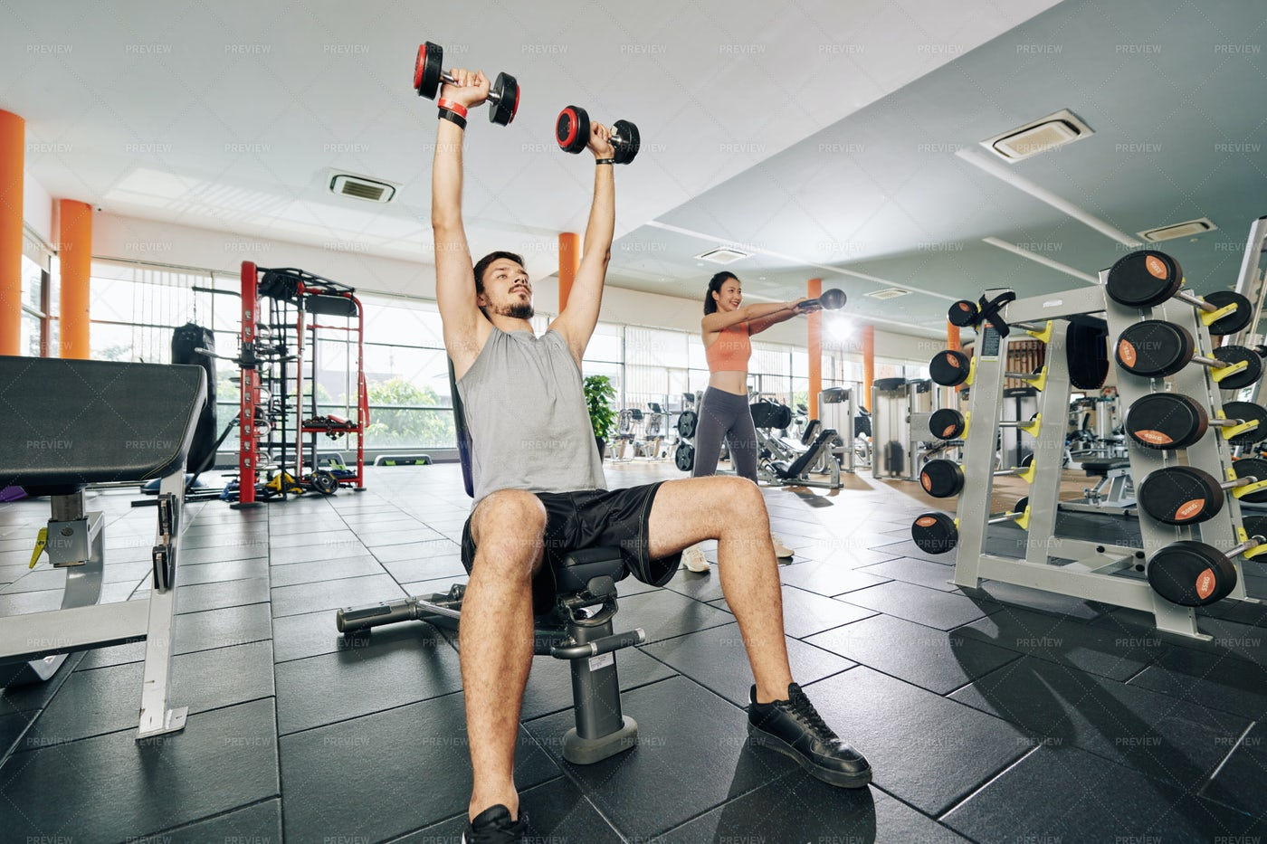 Young Couple Exercising In Gym: Stock Photos