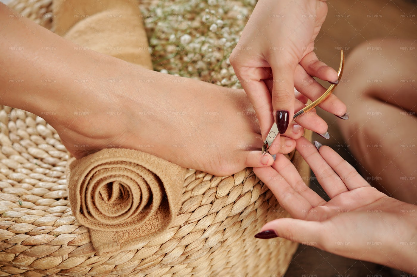 Pedicurist Cutting Cuticle: Stock Photos