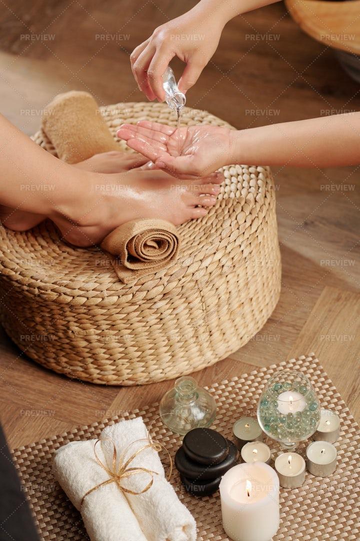 Applying Massage Oil Of Feet: Stock Photos