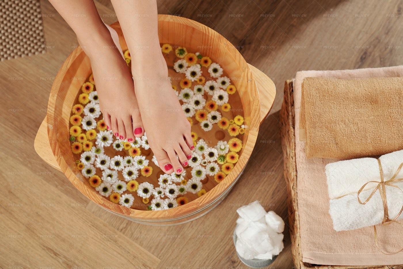 Woman Putting Feet In Warm Water: Stock Photos