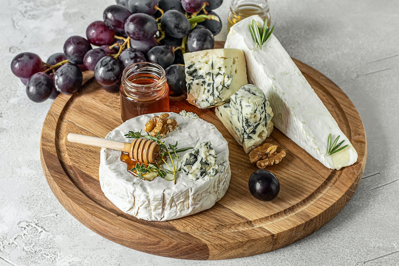 Wooden Board With French Cheese: Stock Photos