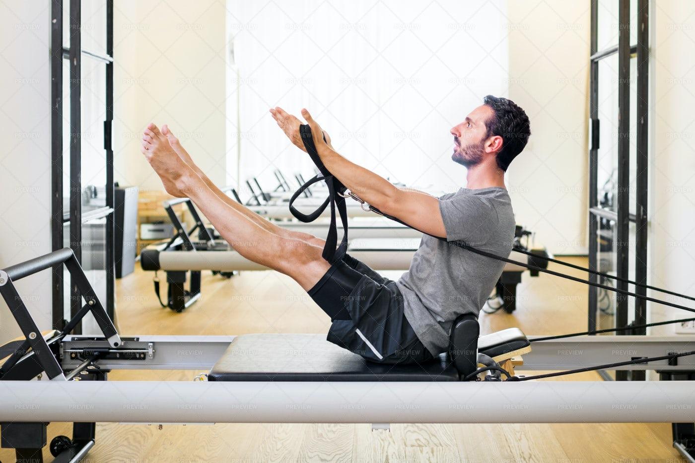 Muscular Man Doing  Pilates Exercise: Stock Photos