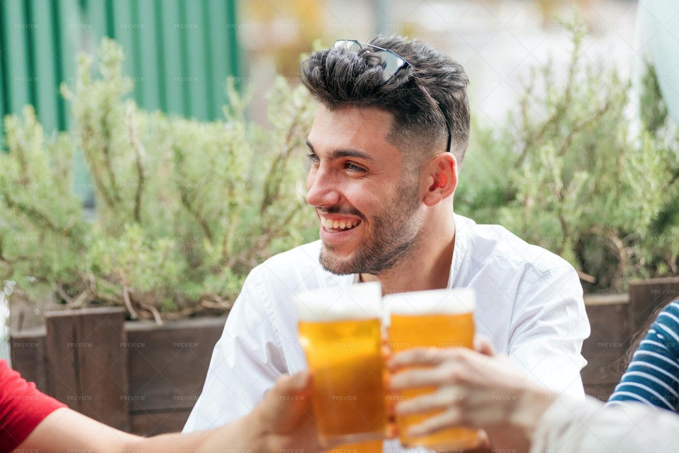 Smiling Man Celebrating: Stock Photos
