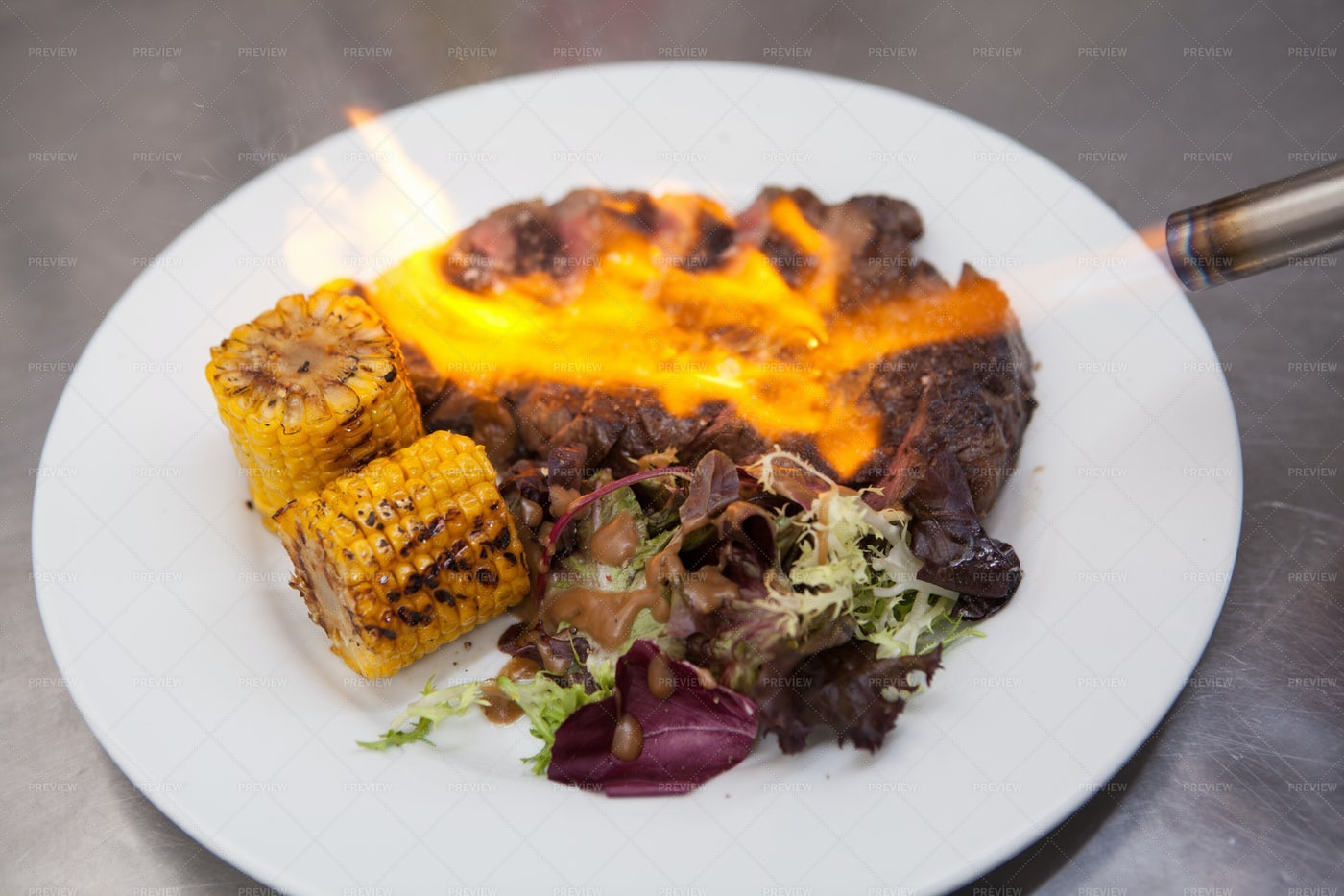 Using Blowtorch On A Plate: Stock Photos