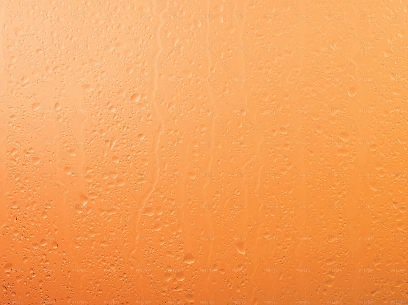Raindrops On Orange Glass: Stock Photos